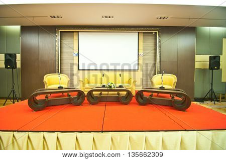 stage seminar with microphone and sofa waiting for seminar