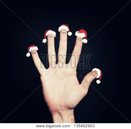 Christmas Happy Face Fingers Looking at empty Background Copy Space