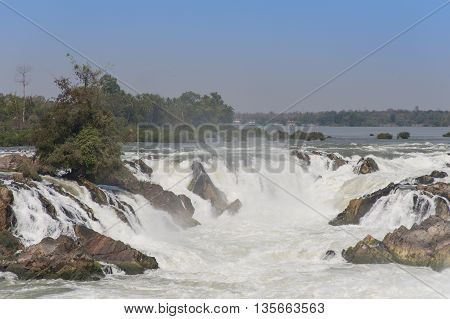 Raging Water Flowing Down Waterfall During Rainy Season Showing Rock Formations.