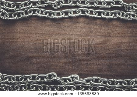 big chains on the brown wooden background