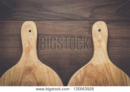 old cutting boards on the wooden table