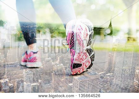 Close up picture of pink sneakers against new york skyline