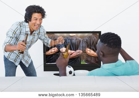 Soccer fans watching tv against rugby players standing together before match