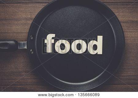 big pan on the table with word food