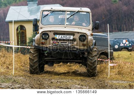 Lviv Ukraine - February 21 2016: Off-road vehicle brand UAZ overcomes the track on a amateur competitions Trial near the city Lviv Ukraine