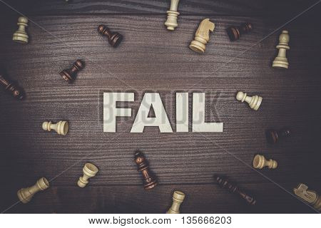 fail concept on the brown wooden background