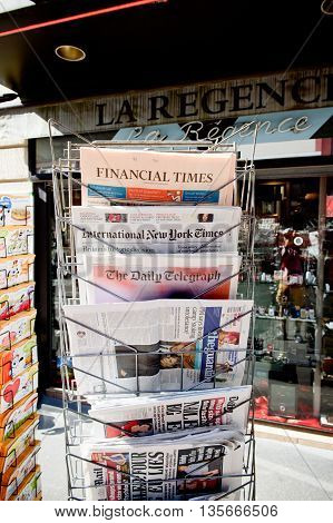 STRASBOURG FRANCE - JUN 24 2016: International New York Times Financial Times The Daily Telegraph The Guardian and other major newspapers headline titles at press kiosk about the Brexit referendum in United Kingdom to quit Europe