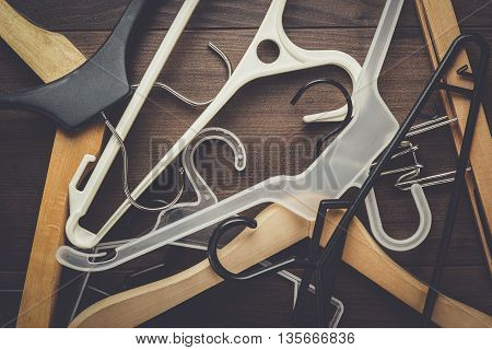 clothing hanger on the brown wooden table