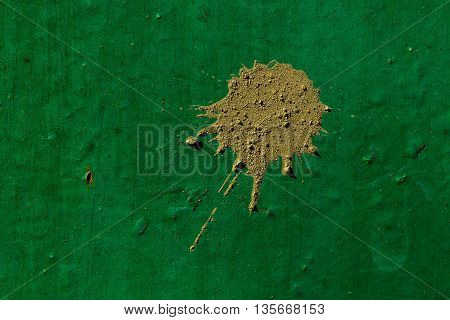 Bright green abstract metal background with dirty mud blotch