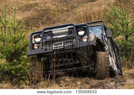 Lviv Ukraine - February 21 2016: Off-road vehicle UAZ overcomes the track on of landfill near the city Lviv.