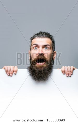 Bearded Scared Man With Paper