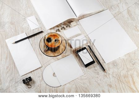 Photo of blank stationery set. Blank ID template on light wooden background. Mock-up for branding identity. Blank template for your design.