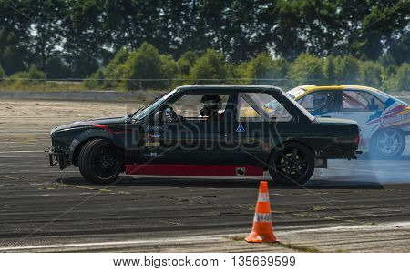 VinnytsiaUkraine-July 25 2015: Riders Alexey Kosogov and V. Borovitsky on the cars brand BMW overcomes the track in the Drift championship of Ukraine on July 252015 in Vinnytsia Ukraine.