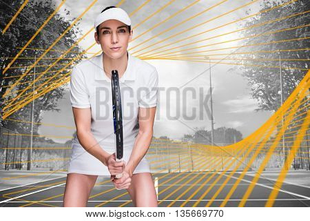 Female athlete playing tennis against composite image of tennis field on a sunny day