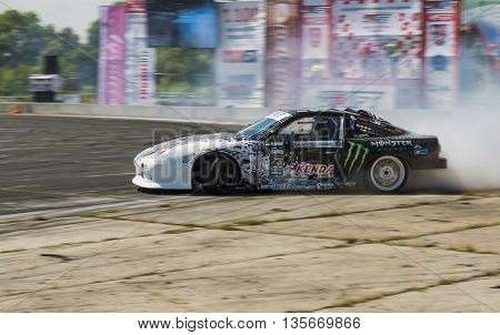 VinnytsiaUkraine-July 25 2015: Rider Dmytro Illyuk on the car brand Nissan overcomes the track in the Drift championship of Ukraine on July 252015 in Vinnytsia Ukraine.