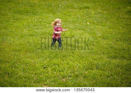 Small Boy On Green Grass