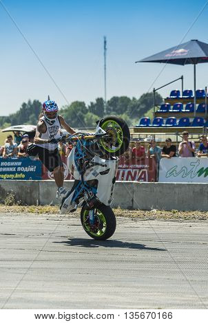 Vinnytsia Ukraine-July 25 2015: Unknown stunt biker entertain the audience before the start of the