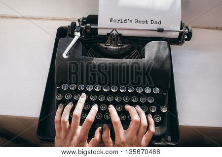 Hands typing on typewriter worlds best dad