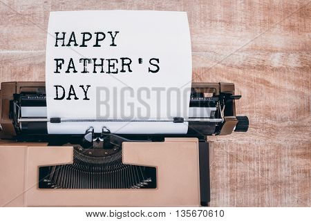 Happy fathers day written on paper with typewriter