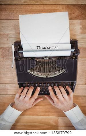 Thanks dad message against businessman working on typewriter at table in office
