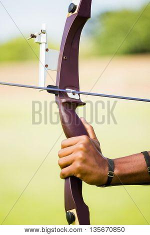 Athlete practicing archery in stadium
