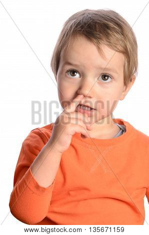 Cute child with finger in his nose on white background