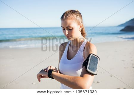 Fit woman on the beach on a sunny day