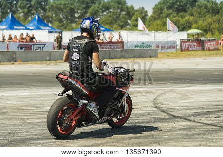 Vinnytsia Ukraine-July 25 2015: Unknown stunt biker entertain the audience before the start of the championship of drifting on July 25 2015 in Vinnytsia Ukraine.