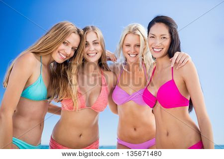 Portrait of friends posing at the beach on a sunny day