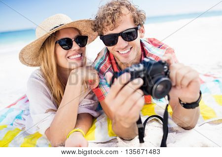 Portrait of couple posing at the beach on a sunny day