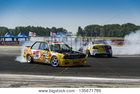 Vinnytsia Ukraine-July 25 2015: Riders on the cars brand BMW makes a mistake on the track in the Drift championship of Ukraine on July 252015 in Vinnytsia Ukraine.