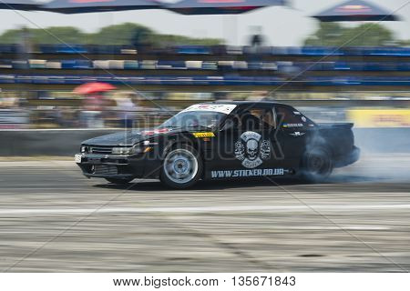 Vinnytsia Ukraine-July 25 2015: Rider Nikolay Volkov on the car brand Nissan overcomes the track in the Drift championship of Ukraine on July 252015 in Vinnytsia Ukraine.