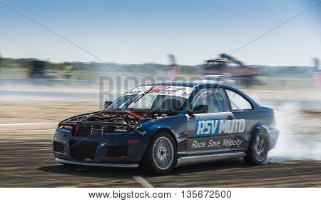 Vinnytsia Ukraine-July 24 2015: Unknown rider on the car brand BMW overcomes the track in the Drift championship of Ukraine on July 242015 in Vinnytsia Ukraine.
