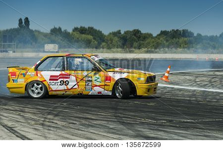 Vinnytsia Ukraine-July 24 2015: Rider Vladimir Palariev on the car brand BMW makes a mistake on the track in the Drift championship of Ukraine on July 242015 in Vinnytsia Ukraine.