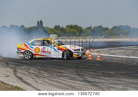 Vinnytsia Ukraine-July 24 2015: Rider V. Borovitsky on the car brand BMW makes a mistake on the track in the Drift championship of Ukraine on July 242015 in Vinnytsia Ukraine.