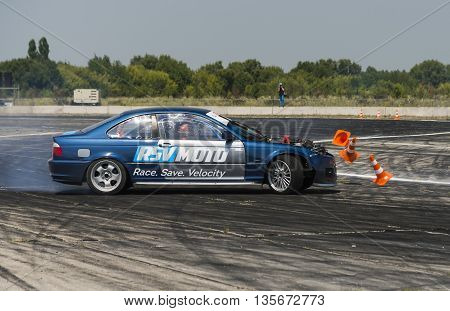 Vinnytsia Ukraine-July 24 2015: Unknown rider on the car brand BMW makes a mistake on the track in the Drift championship of Ukraine on July 242015 in Vinnytsia Ukraine.