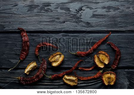 Chili Pepper And Apple On Wooden Board