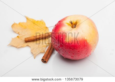 Apple And Cinnamon With Leaf Isolated On White