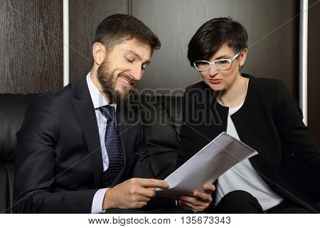 business partners in the office studying documents