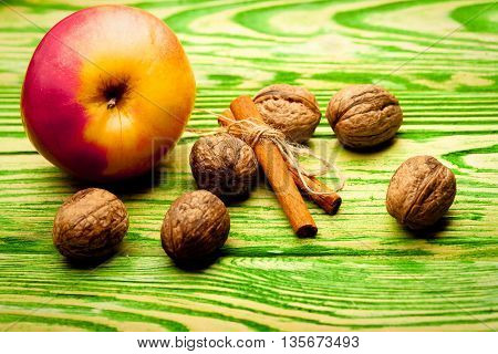 Walnut Apple And Cinnamon On Green Wood