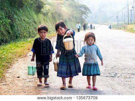 YEN BAI, VIETNAM, June 13, 2016 the group of children, Hmong, highland Yen Bai, walking, to boarding schools