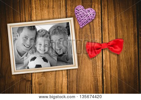 Portrait of smiling son, father and grandfather on floor against wooden table