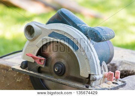 Circular saw electric tools with wood shavings