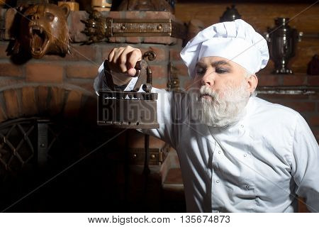 Senior Cook With Coal Iron