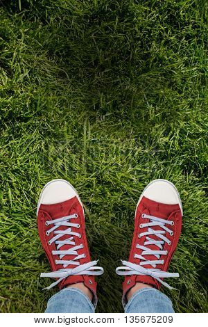 Casual shoes against grass background