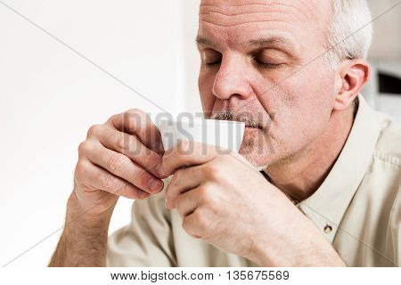 Contented Man Sipping From Tea Cup