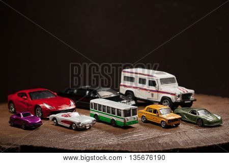 A set of toy cars cars of different sizes and colors