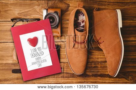 fathers day greeting against everyday usable vintage objects on wooden table