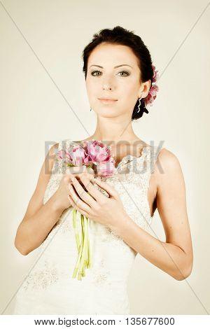 beautiful Woman fiancee in vintage dress on light backgrund
