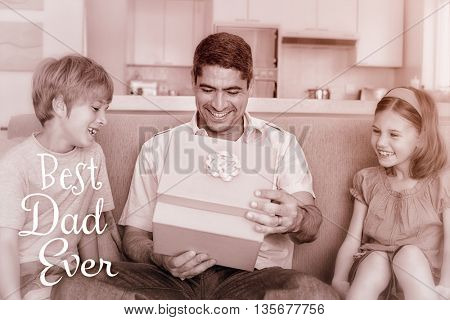 Father opening gift given by children on sofa against word best dad ever on a white background